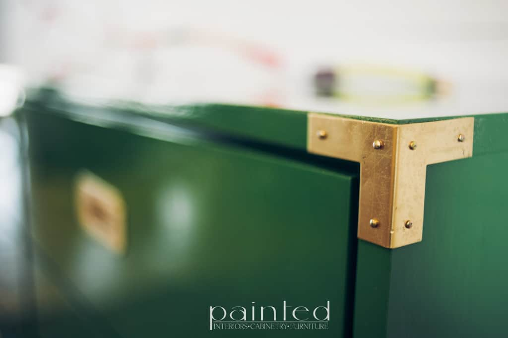 glossy green campaign dresser painted in Fine Paints of Europe Hollandlac Brilliant with brass hardware. brass corner bracket