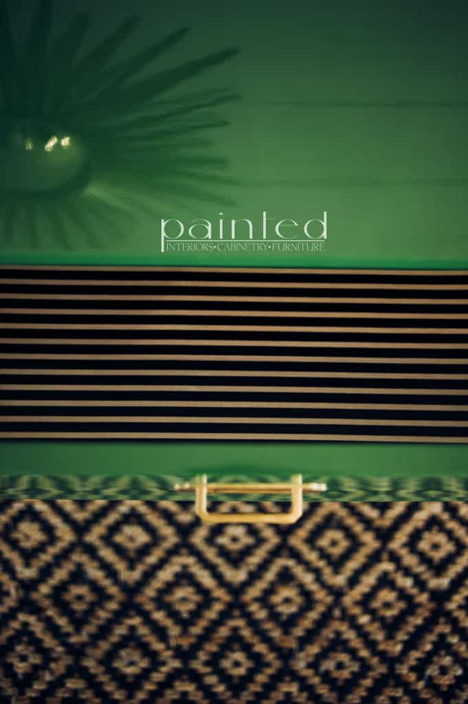 glossy green campaign dresser painted in Fine Paints of Europe Hollandlac Brilliant with brass hardware