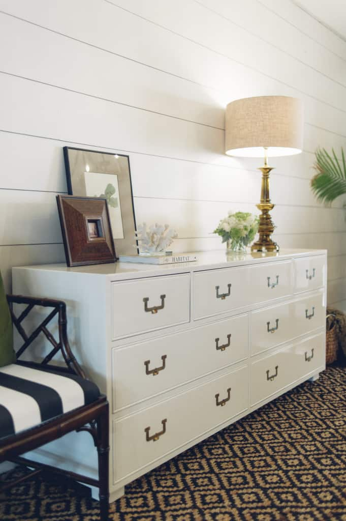 Vintage Henredon Artefacts Campaign dresser with brass hardware painted with high gloss oil enamel Fine Paints of Europe Hollandlac Brilliant in Benjamin Moore White Dove shiplap walls Chinese Chippendale chair Lacy Tomlinson Photography