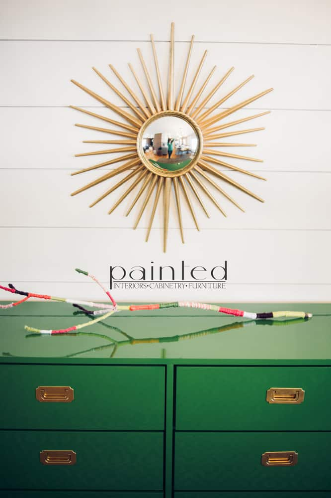 glossy green campaign dresser painted in Fine Paints of Europe Hollandlac Brilliant with brass hardware ship lap walls sunburst mirror yarn covered stick