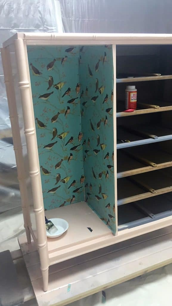 Using Mod Podge to adhere paper into Stanley bamboo Tallboy wardrobe