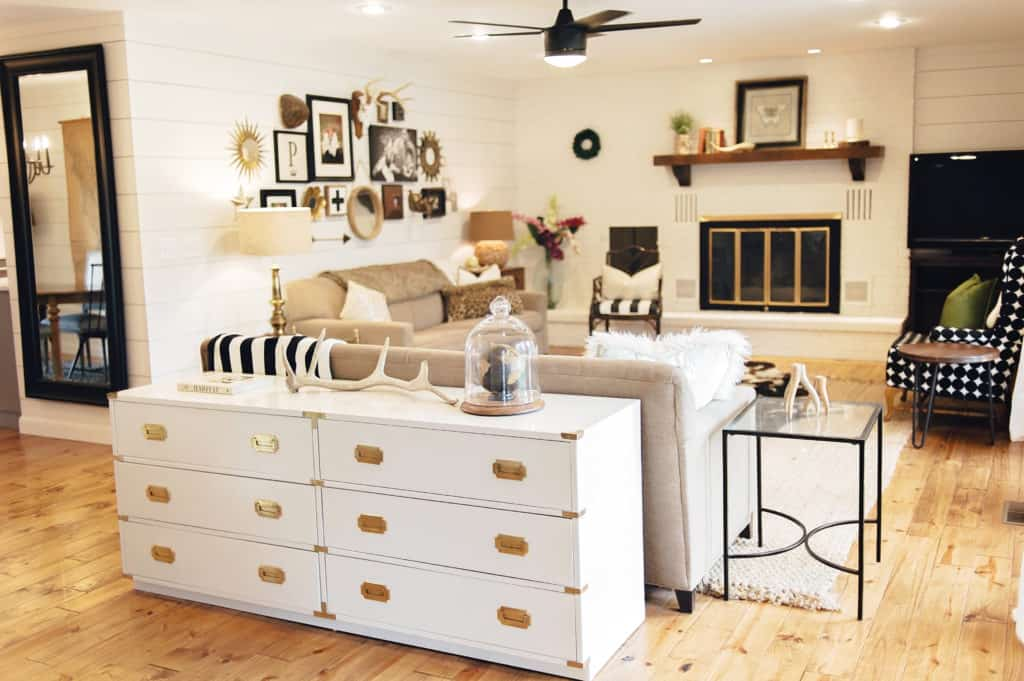 Light and airy updated living room adorned in shiplap makes for a modern farmhouse retreat.