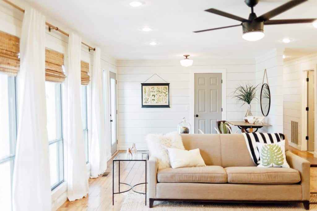 White curtains and bamboo blinds keep this modern farmhouse feeling relaxed and casual.