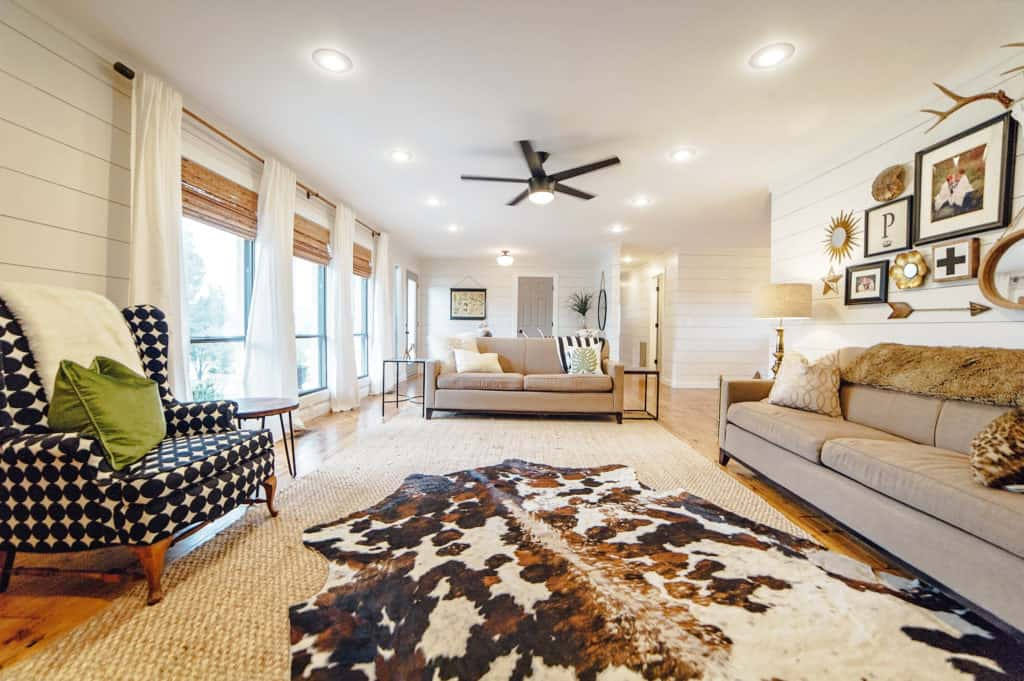 Cowhide layered over a Jute rug brings a ton of natural texture into this updated living room!