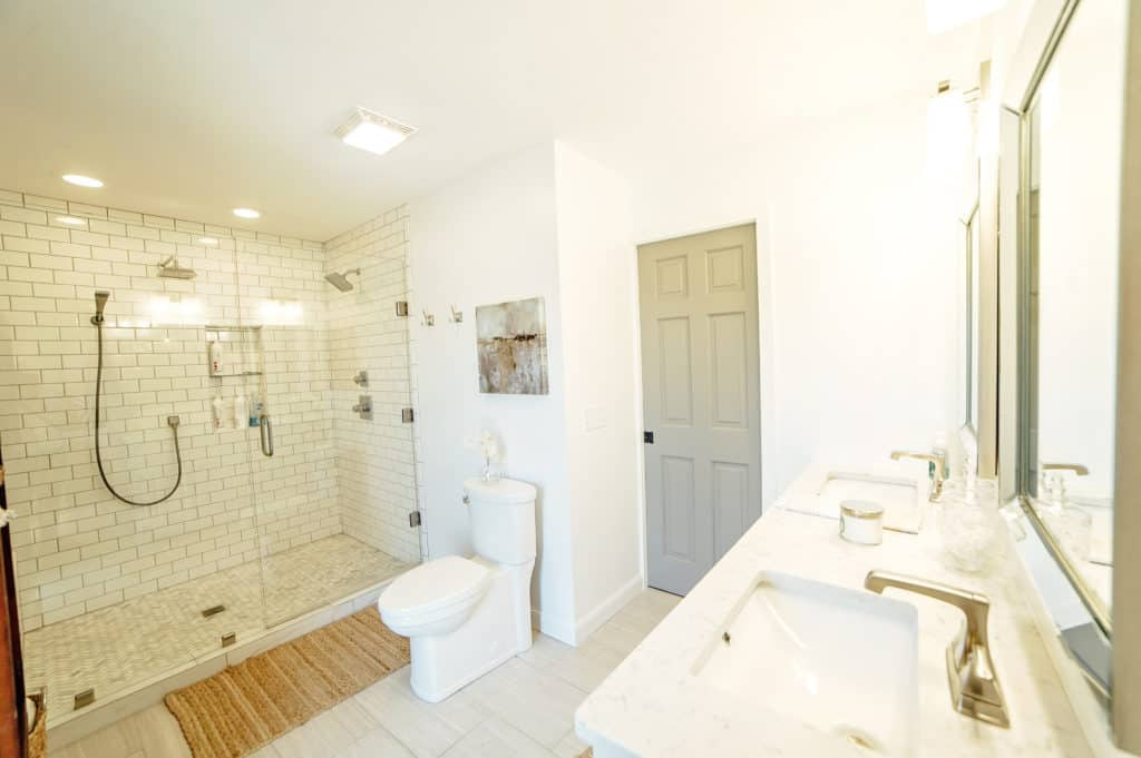 This gorgeous master bathroom features a huge subway tile walk-in shower you'll have to see to believe!