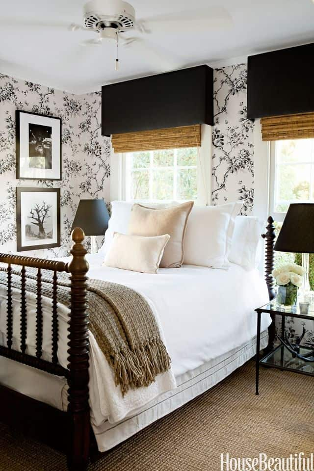 Farmhouse style bedroom with black and white floral wallpaper.