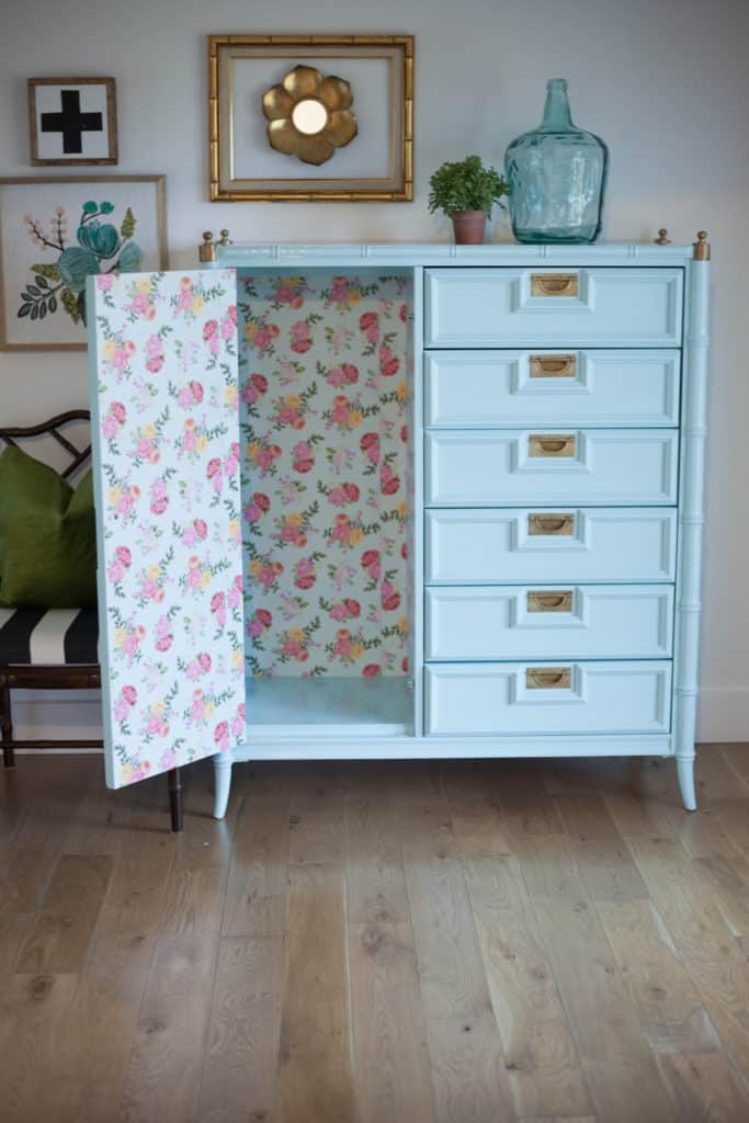 Attaching craft paper to furniture using mod podge. How to take your boring furniture and turn it into a beautiful, one of a kind piece!