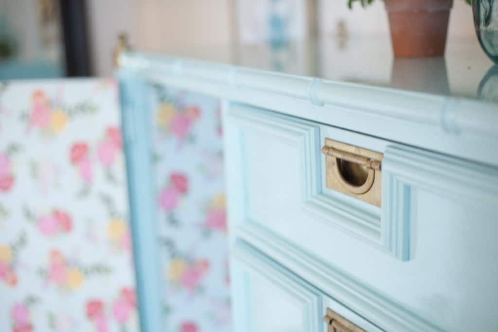 You won't believe how ugly this piece of furniture started out! Stunning before and after pictures of this glossy faux bamboo chest of drawers will make you swoon!