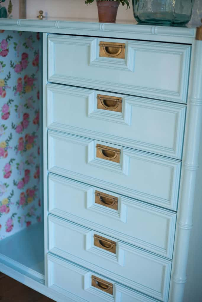 How I transformed an ugly piece of furniture into this gorgeous chest of drawers with paint, paper, and mod podge!