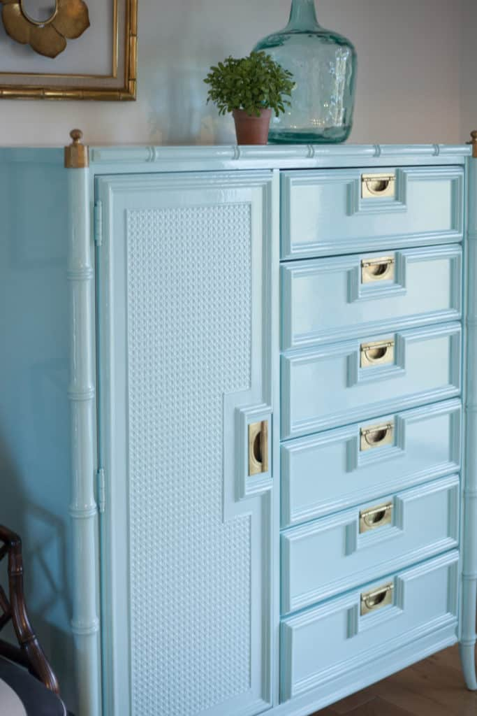 Stanley faux bamboo chest of drawers lacquered in custom shade of high gloss aqua. Polished brass campaign hardware makes this vintage piece of furniture pop!