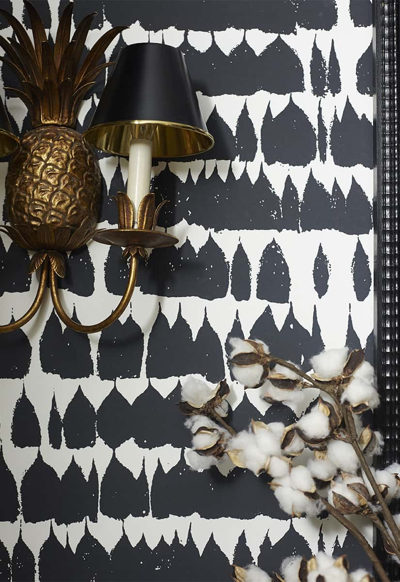 Schumacher's Queen of Spain wallpaper in black and white is utterly stunning in this powder bathroom.