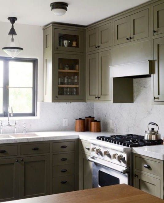 Gorgeous Olive cabinetry feels modern and fresh paired with black hardware.