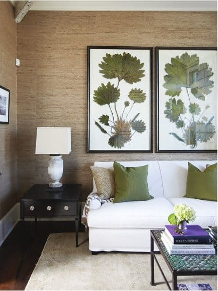 Huge botanical prints in grasscloth covered living room. Gorgeous!