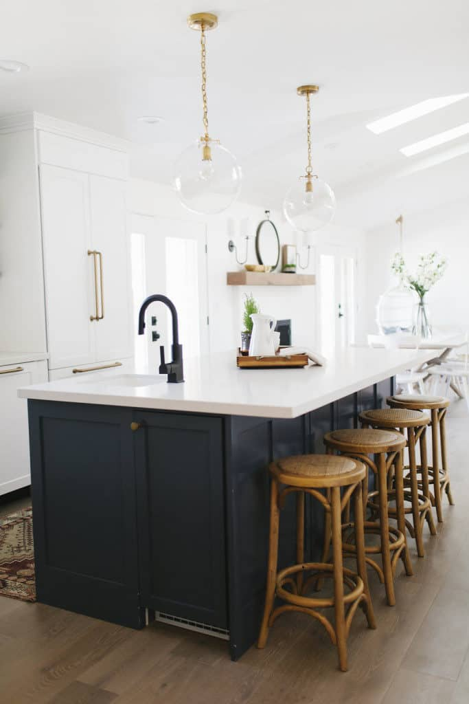 Black kitchen faucet with brass hardware.