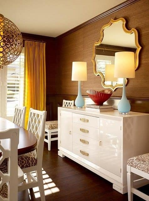 Glossy credenza steals the show in this chic dining room. Hot Home Trends for 2018