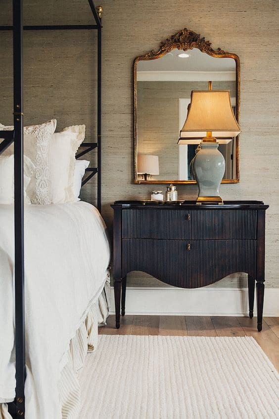 Natural grasscloth brings a great warmth to this stunning bedroom! Hot Home Trends for 2018