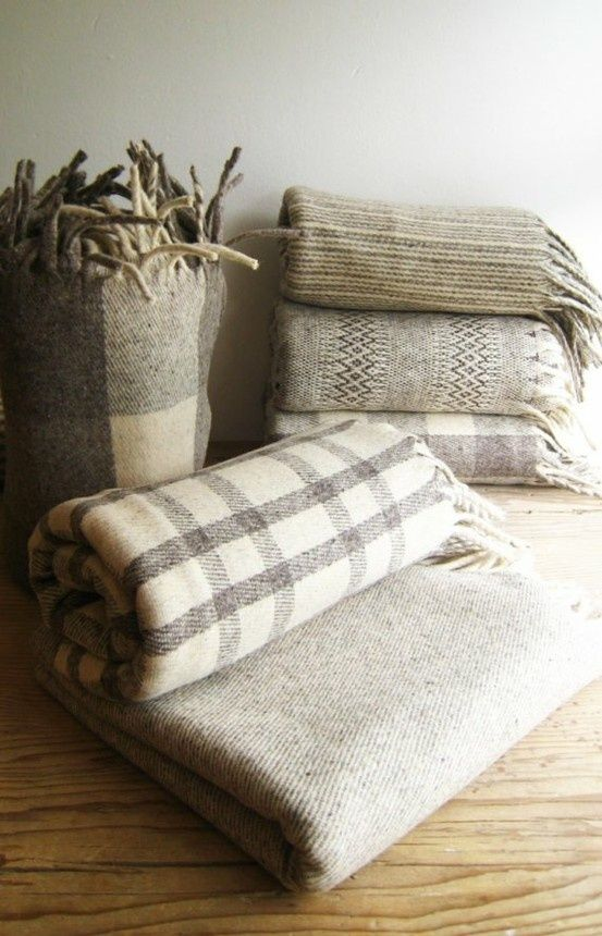 Wonderfully cozy wool blankets in classic gray and cream tartan.