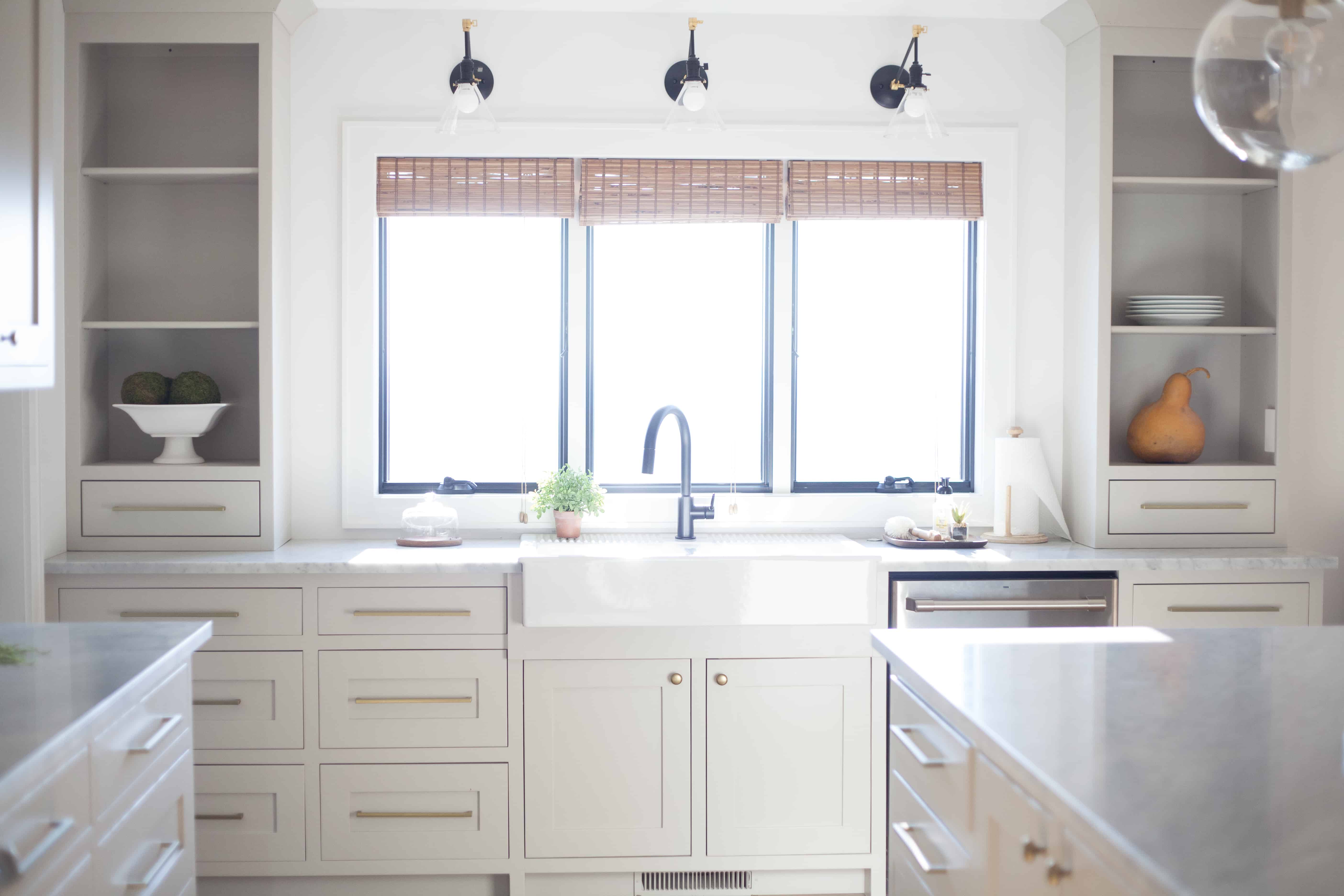 Farmhouse sink with black faucet. Kitchen window with a view. Black ...