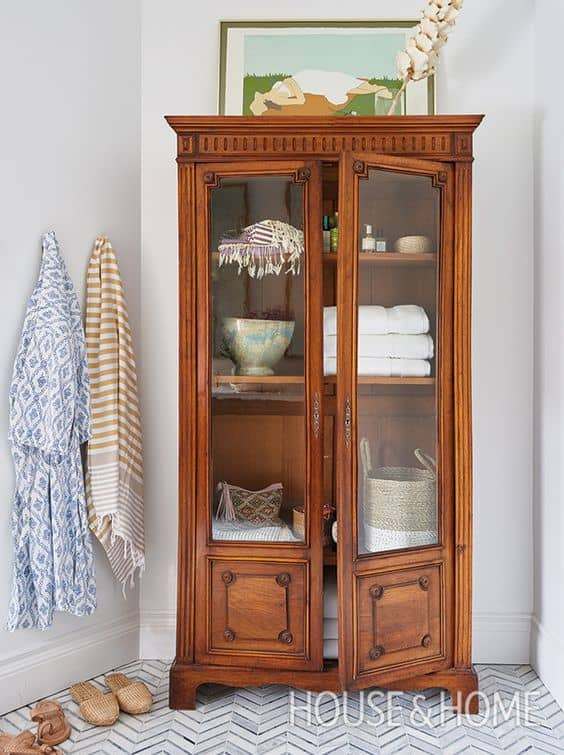 Better bathroom storage options. - Antique China Cabinet In The Bathroom Used For Storage - Painted By