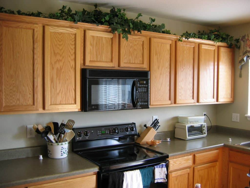 Greenery Above Kitchen Cabinets 5 Kitchen Decor Items You Should Ditch   Painted by Kayla Payne