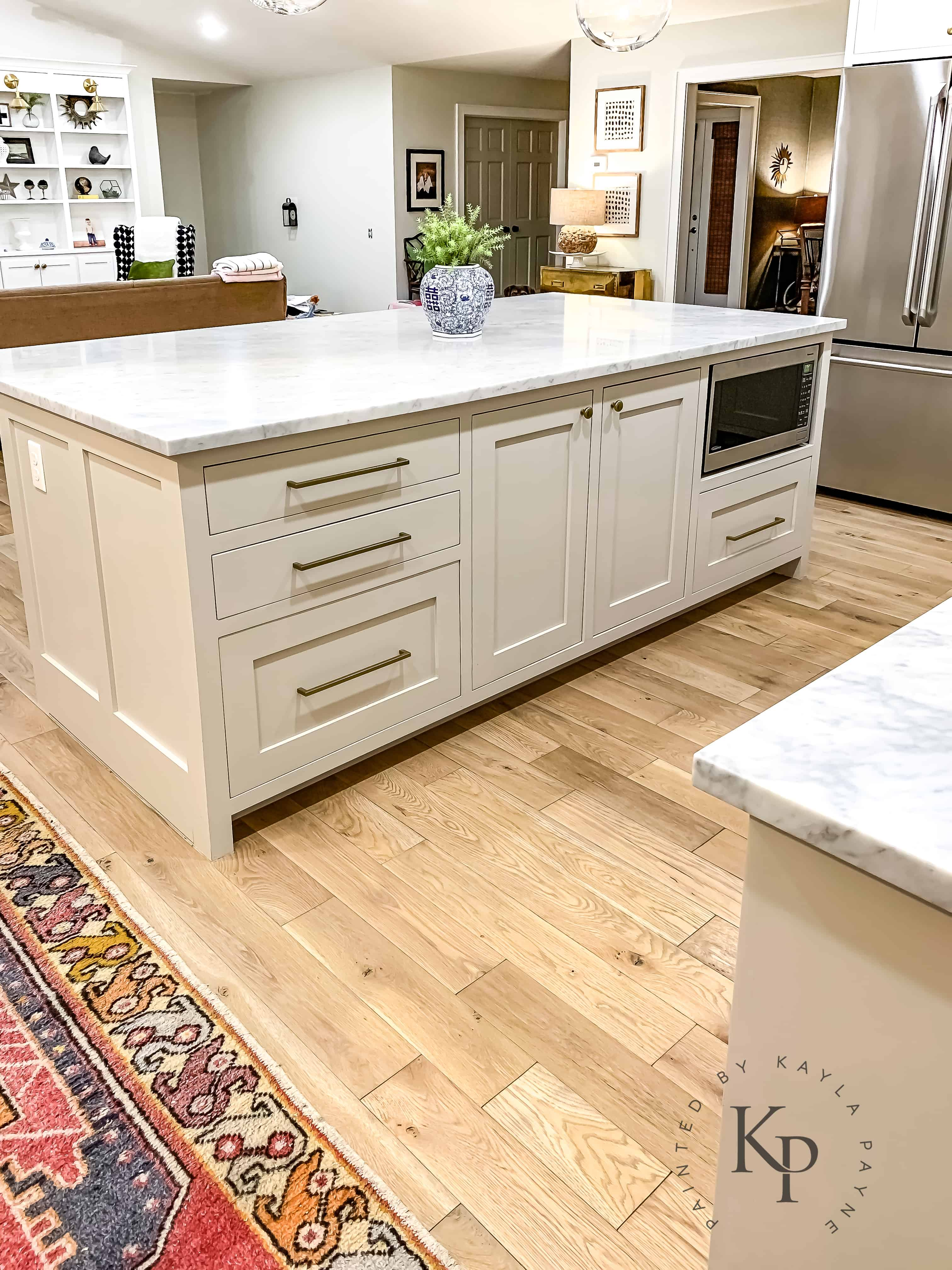 astounding white kitchen cabinets wood floors | Carrara Marble Countertops, marble countertop island ...