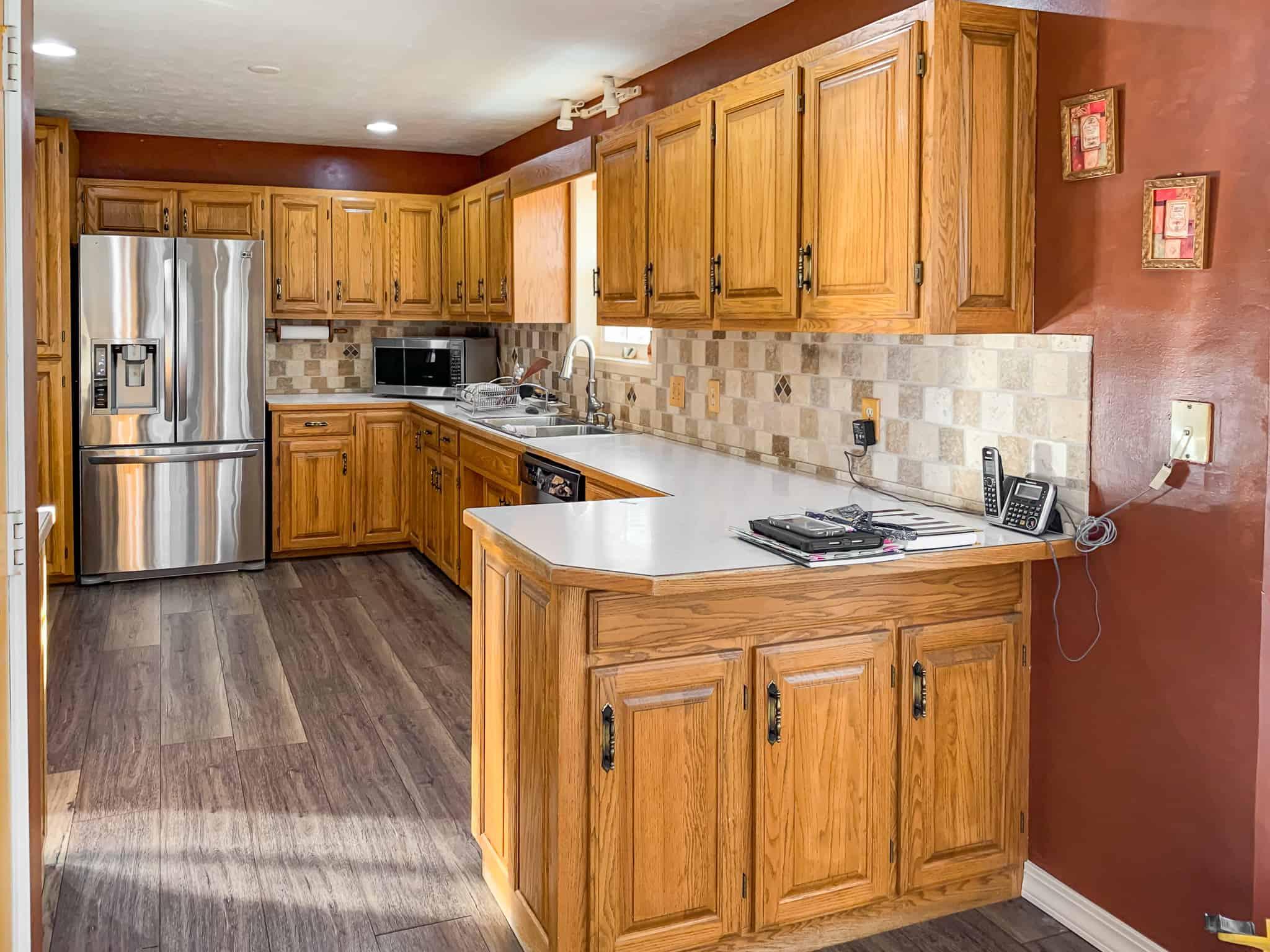 Honey oak kitchen cabinets-01 - Painted by Kayla Payne
